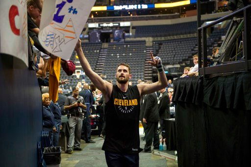 (AP Photo/Brandon Dill, File). FILE - In this Feb. 23, 2018, file photo, Cleveland Cavaliers forward Kevin Love greets fans before an NBA basketball game against the Memphis Grizzlies, in Memphis, Tenn. The All-Star forward, who has been sidelined sinc...