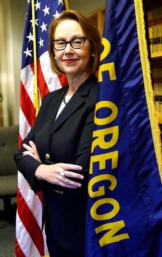 (AP Photo/Don Ryan, File). FILE - In this July 13, 2016, file photo, Oregon Attorney General Ellen Rosenblum poses for a photo at her office in Portland, Ore. The state of Oregon has sued Nevada gambling mogul Steve Wynn and the board of directors of W...