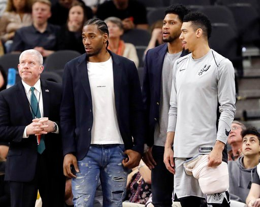 (AP Photo/Eric Gay, File). FILE - In this Jan. 21, 2018, file photo, San Antonio Spurs guard Danny Green, right, stands at the bench with injured teammates Kawhi Leonard, second from left, and Rudy Gay, center, during the second half of an NBA basketba...