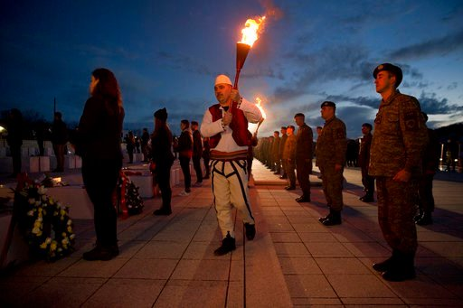 "(AP Photo/Visar Kryeziu). A Kosovo Albanian man in national costume holds a torch during a bonfire ceremony ""Night of the Fires"" in the village of Prekaz, Kosovo on Wednesday, March 7, 2017. Kosovo Liberation Army (KLA) commander Adem Jashari was kille..."
