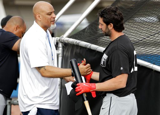 (AP Photo/Chris O'Meara). Tony Clark, left, head of the Major League Baseball Players Association, shakes hands with free agent player Chris Colabello before an exhibition baseball game against JR East, a Japanese amateur team, Tuesday, Feb. 27, 2018, ...