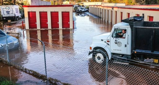 (John Spink/Atlanta Journal-Constitution via AP). A truck drives through water from a water main break in Doraville, Ga., Wednesday, March 7, 2018. The massive water main break Wednesday morning left residents outside Atlanta without water, sent water ...