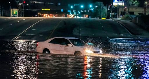 (John Spink/Atlanta Journal-Constitution via AP). A car crashes into a water main break in Doraville, Ga., Wednesday, March 7, 2018. The massive water main break Wednesday morning left residents outside Atlanta without water, sent water gushing into ne...