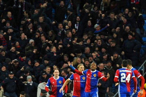 (AP Photo/Rui Vieira). Basel's Michael Lang, second from left, celebrates with his teammates after scoring his side's second goal during the Champions League, round of 16, second leg soccer match between Manchester City and Basel at the Etihad Stadium ...