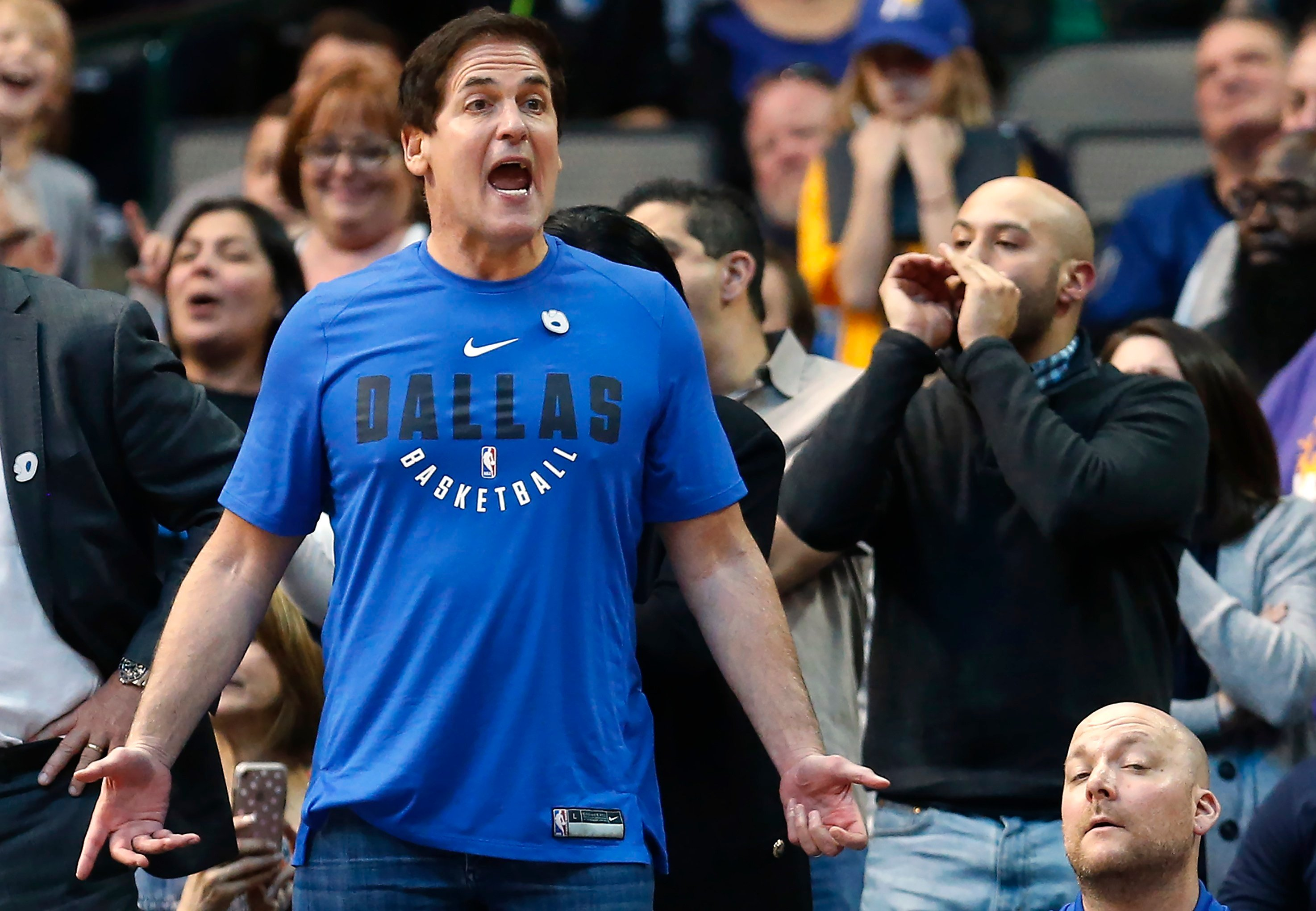 Dallas Mavericks owner Mark Cuban, left, reacts as his team plays the Indiana Pacers during the second half of an NBA basketball game, Monday, Feb. 26, 2018, in Dallas. Cuban is denying a 2011 allegation of sexual assault. (Source: AP Photo/Ron Jenkins)