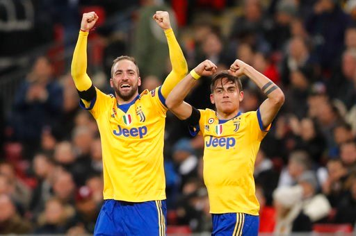 (AP Photo/Frank Augstein). Juventus' Paulo Dybala, right, celebrates with his teammate Gonzalo Higuain after scoring his side second goal during the Champions League, round of 16, second-leg soccer match between Juventus and Tottenham Hotspur, at the W...