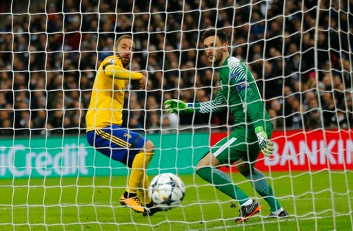 (AP Photo/Frank Augstein). Juventus' Gonzalo Higuain scores his side first goal during the Champions League, round of 16, second-leg soccer match between Juventus and Tottenham Hotspur, at the Wembley Stadium in London, Wednesday, March 7, 2018.