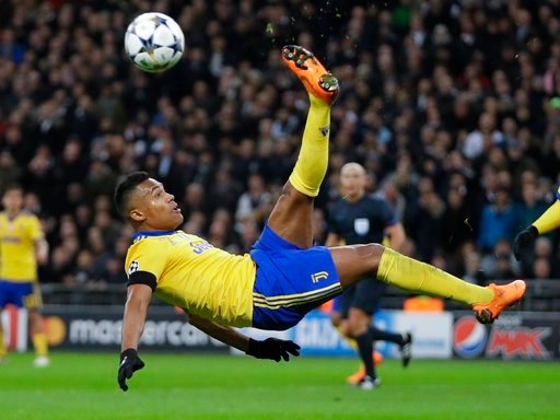 (AP Photo/Kirsty Wigglesworth). Juventus' Alex Sandro performs an acrobatic kick during the Champions League, round of 16, second-leg soccer match between Juventus and Tottenham Hotspur, at the Wembley Stadium in London, Wednesday, March 7, 2018.