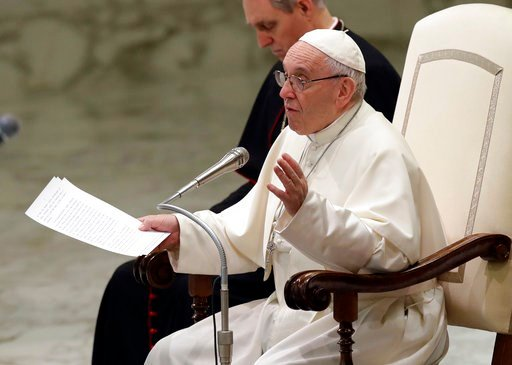 (AP Photo/Alessandra Tarantino). Pope Francis talks during the weekly general audience in the Paul VI Hall at the Vatican, Wednesday, March 7, 2018.
