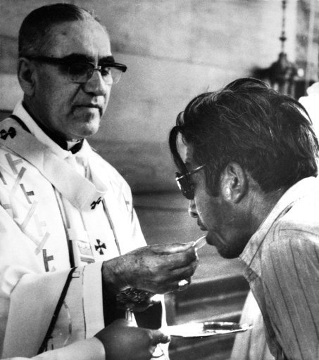 (AP Photo/Cotera, file). FILE - Archbishop Oscar Arnulfo-Romero offers the host wafer during the communion rite to a member of the congregation during a church mass in San Salvador, El Salvador on Jan. 13, 1980. Pope Francis has cleared the way for sla...