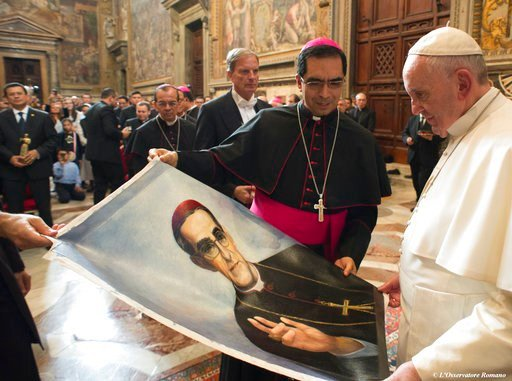(L'Osservatore Romano/Pool Photo via AP). FILE -- In this Oct. 30, 2015 file photo, Pope Francis is presented with an image of Roman Catholic Archbishop Oscar Romero during a private audience granted to participants to the pilgrimage from El Salvador a...