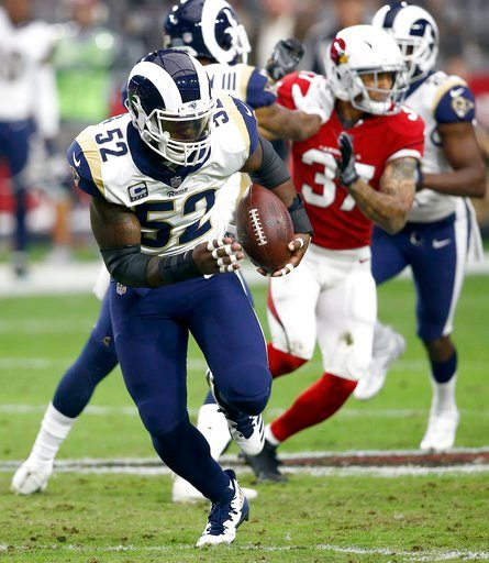 (AP Photo/Ross D. Franklin, File). FILE - In this Dec. 3, 2017, file photo, Los Angeles Rams inside linebacker Alec Ogletree (52) returns an interception for a touchdown during the first half of an NFL football game against the Arizona Cardinals in Gle...