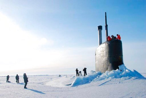 (U.S. Navy via AP). This 2016 photo provided by the U.S. Navy, shows a submarine after breaking through ice in the Beaufort Sea off Alaska's north coast. The U.S. Navy has kicked off biennial submarine testing and training under sea ice off Alaska's no...