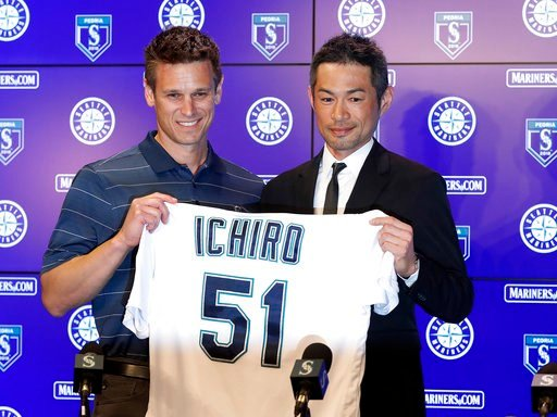 (AP Photo/Matt York). Seattle Mariners' Ichiro Suzuki, right, holds up his jersey with Mariners general manager Jerry Dipoto during a news conference at the teams' spring training baseball complex Wednesday, March 7, 2018, in Peoria, Ariz. Suzuki signe...