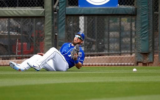 (AP Photo/Ross D. Franklin). Kansas City Royals left fielder Alex Gordon is unable to come up with a ball hit by Milwaukee Brewers' Domingo Santana during the fourth inning of a spring training baseball game Wednesday, March 7, 2018, in Surprise, Ariz.
