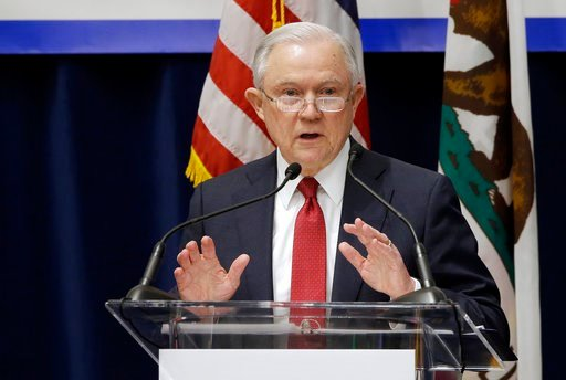 (AP Photo/Rich Pedroncelli). U.S. Attorney General Jeff Sessions addresses the California Peace Officers' Association 26th Annual Law Enforcement Legislative Day, 7, 2018, in Sacramento, Calif. The Trump administration on Tuesday sued to block Californ...