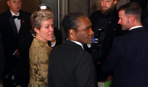 (AP Photo/Jeff Turner). This image taken from video shows Oscar winner Frances McDormand, foreground left, walking into the Governors Ball next to Terry Bryant, center, the man accused of stealing her Academy Award on Sunday, March 4, 2018 in Los Angel...