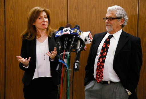 (AP Photo/Damian Dovarganes). Rabbi Naomi Levy, left, and Attorney Daniel Brookman appear on behalf of defendant Terry Bryant, as the media awaits his appearance in Los Angeles Superior Court Wednesday, March 7, 2018. Bryant is accused of stealing Fran...