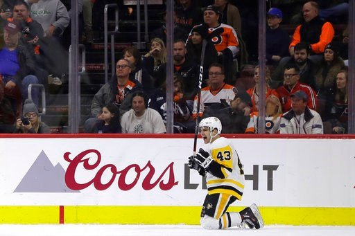 (AP Photo/Matt Slocum). Pittsburgh Penguins' Conor Sheary celebrates after a goal during the second period of an NHL hockey game against the Philadelphia Flyers, Wednesday, March 7, 2018, in Philadelphia.