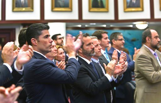 (Scott Keeler/Tampa Bay Times via AP). Rep. Jose Oliva, R- Miami Lakes, front, and other members of the Florida House, applaud Marjory Stoneman Douglas High School parent Andrew Pollack, who's daughter, Meadow Pollack, was killed in the school shooting...