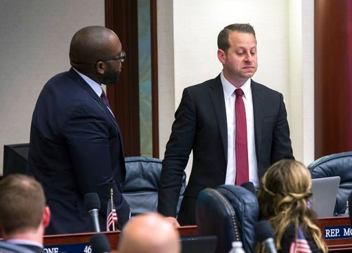 (AP Photo/Mark Wallheiser). Florida Rep. Jared Moskowitz, right, D-Coral Springs, regains his composure during his debate of the school safety bill as Rep. Shevrin D. Jones, D-West Park, looks on just prior to the vote at the Florida Capital in Tallaha...