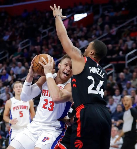 (AP Photo/Carlos Osorio). Detroit Pistons forward Blake Griffin (23) looks to shoot as Toronto Raptors forward Norman Powell defends during the first half of an NBA basketball game Wednesday, March 7, 2018, in Detroit.