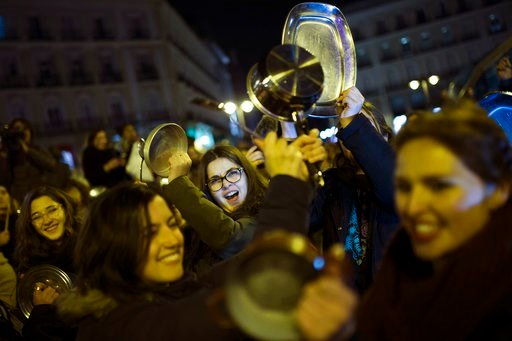 (AP Photo/Francisco Seco). Women bang pots and pans as shooting slogans during a protest marking the beginning of a 24-hour women strike at the Sol square in Madrid, early Thursday, March 8, 2018. Women in Spain have been called for a 24-hour feminist ...