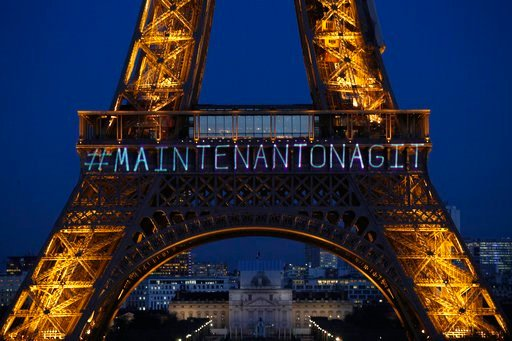 """(AP Photo/Francois Mori). The powerful message """"Maintenant On Agit"""" (""""Now We Act"""") is projected on the Eiffel Tower on the eve of International Women's Day to honor women's rights and promote the French equivalent of the Time's Up movement in Paris, We..."""