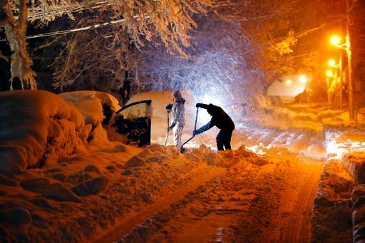 (Bob Karp/The Record via AP). Residents on Mills Street dig out their car after a snowstorm dumped over a foot of snow around the area Wednesday, March 7, 2018, in Morristown, N.J.