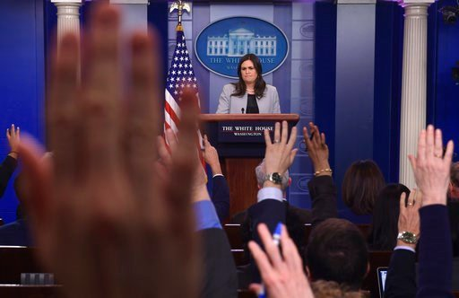 (AP Photo/Susan Walsh). White House press secretary Sarah Huckabee Sanders listens to a reporter's question during the daily briefing at the White House in Washington, Wednesday, March 7, 2018.