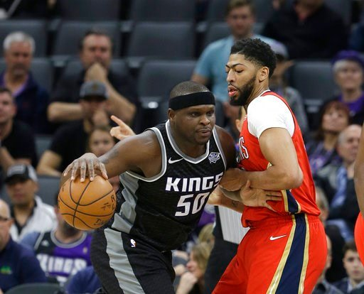 (AP Photo/Rich Pedroncelli). New Orleans Pelicans forward Anthony Davis, right, tries to stop Sacramento Kings forward Zach Randolph, left, during the first quarter of an NBA basketball game Wednesday, March 7, 2018, in Sacramento, Calif.