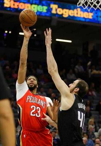 (AP Photo/Rich Pedroncelli). New Orleans Pelicans forward Anthony Davis, left, shoots over Sacramento Kings center Kosta Koufos during the first quarter of an NBA basketball game Wednesday, March 7, 2018, in Sacramento, Calif.