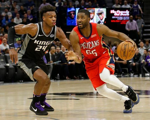 (AP Photo/Rich Pedroncelli). New Orleans Pelicans forward E'Twaun Moore, right, drives against Sacramento Kings guard Buddy Hield during the second quarter of an NBA basketball game Wednesday, March 7, 2018, in Sacramento, Calif.