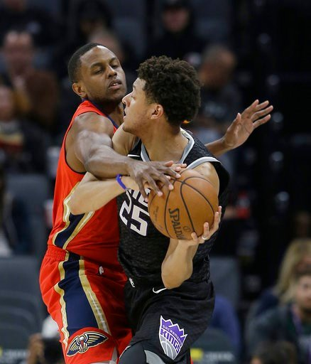 (AP Photo/Rich Pedroncelli). Sacramento Kings forward Justin Jackson, right, tries to keep the ball out of the reach of New Orleans Pelicans forward Darius Miller, during the first quarter of an NBA basketball game Wednesday, March 7, 2018, in Sacramen...