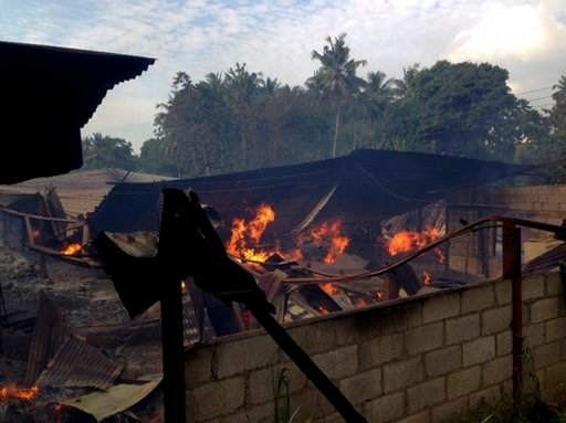 (AP Photo/Bharatha Mallawarachchi). A timber depot burns in Mullegama village in Kandy, Sri Lanka, Wednesday, March. 7, 2018.Religious violence flared anew in the hills of central Sri Lanka on Wednesday despite a state of emergency, with Buddhist mobs ...
