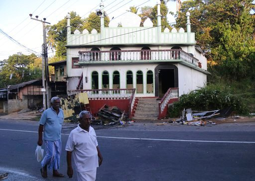 (AP Photo/Rukmal Gamage). Sri Lankans walk past a vandalized Mosque in Diana, in central Sri Lanka, Wednesday, March 7, 2018. Sri Lanka's president declared a state of emergency Tuesday amid fears that anti-Muslim attacks in several central hill towns ...