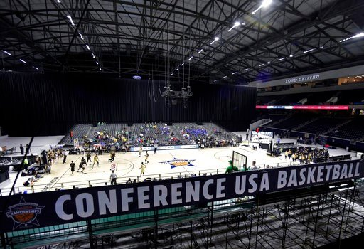 (AP Photo/Tony Gutierrez). Fans watch as Florida International University plays Southern Miss on Court A, on the first day of the men's and women's Conference USA basketball tournament at the Ford Center in Frisco, Texas, Wednesday, March 7, 2018. A la...