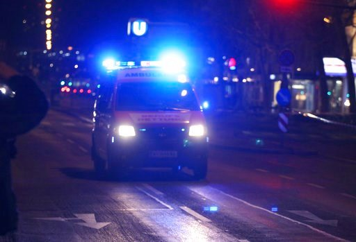 (AP Photo/Ronald Zak). An ambulance drives on the street after several people have been injured in a knife attack on the streets of Vienna, Austria, Wednesday, March 7, 2018.