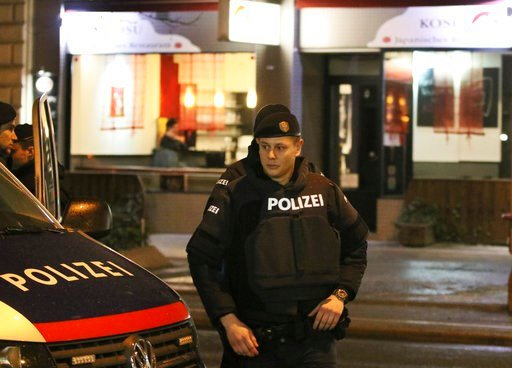 (AP Photo/Ronald Zak). A police officers stands in front of a Japanese restaurant after several people have been injured in a knife attack on the streets of Vienna, Austria, Wednesday, March 7, 2018.