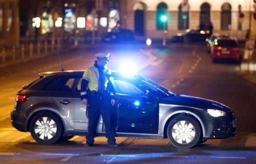 (AP Photo/Ronald Zak). An officer blocks a street when police is on the hunt for an attacker after several people have been injured in a knife attack on the streets of Vienna, Austria, Wednesday, March 7, 2018.