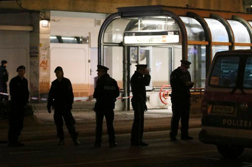 (AP Photo/Ronald Zak). Officers stand at the underground stop Nestroyplatz when police is on the hunt for an attacker after several people have been injured in a knife attack on the streets of Vienna, Austria, Wednesday, March 7, 2018.
