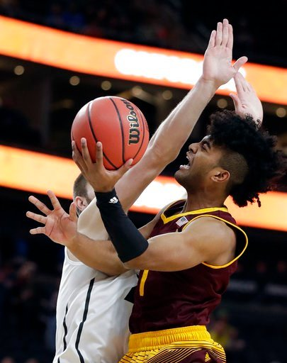 (AP Photo/Isaac Brekken). Arizona State's Remy Martin, right, shoots while defended by Colorado's Lucas Siewert, left, during the first half of an NCAA college basketball game in the first round of the Pac-12 men's tournament Wednesday, March 7, 2018, ...