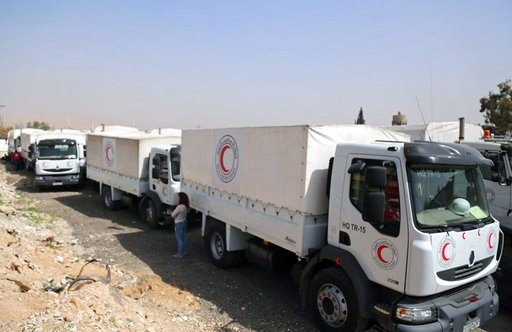 (Syrian Red Crescent via AP). This photo released by the Syrian Red Crescent shows a convoy of vehicles of the Syrian Red Crescent arriving to Douma, eastern Ghouta, a suburb of Damascus, Syria, Monday, March. 5, 2018. Desperate for food and medicine, ...