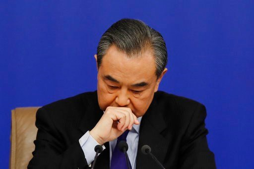 (AP Photo/Andy Wong). China's Foreign Minister Wang Yi pauses as he listens to a question from a journalist during a press conference on the sidelines of the National People's Congress at the media center in Beijing, Thursday, March 8, 2018. China says...