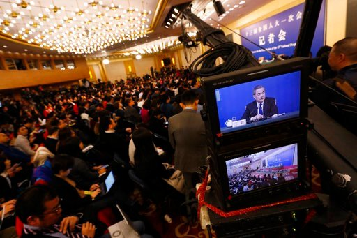 "(AP Photo/Andy Wong). A camera screen shows China's Foreign Minister Wang Yi speaking during a press conference on the sidelines of the National People's Congress at the media center in Beijing, Thursday, March 8, 2018. China says its proposal for a ""d..."