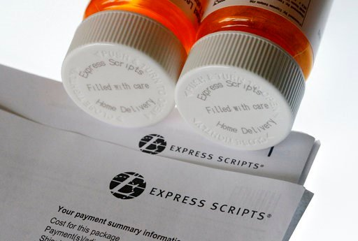 (AP Photo/Wilfredo Lee, File). FILE - In this July 25, 2017, file photo, Express Scripts prescription medication bottles are arranged for a photo in Surfside, Fla. Health insurer Cigna will spend about $52 billion to acquire the pharmacy benefits manag...