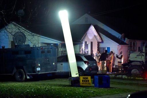 (Keith Myers/The Kansas City Star via AP). Law enforcement officials respond to the scene of a shooting where officer Christopher Ryan Morton was killed and others wounded as they responded to a 911 call on Tuesday evening, March 6, 2018, in Clinton, Mo.