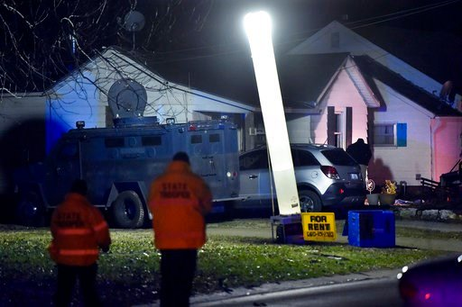 (Keith Myers/The Kansas City Star via AP). Law enforcement officials respond to the scene of a shooting where officer Christopher Ryan Morton was killed and two other officers wounded as they responded to a 911 call on Tuesday evening, March 6, 2018, i...