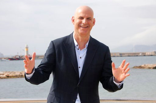 (AP Photo/Lionel Cironneau, File). FILE - In this April 4, 2016 file photo, American author Harlan Coben poses for photographers during the MIPTV, International Television Programme Market in Cannes, southern France. Coben, is changing publishers. Gran...