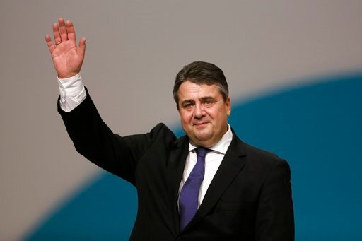 (AP Photo/Markus Schreiber, file). FILE - In this Dec. 11, 2015 file photo German Foreign Minister Sigmar Gabriel waves to the delegates as he receives the applause after his speech during the Social Democratic party convention in Berlin.